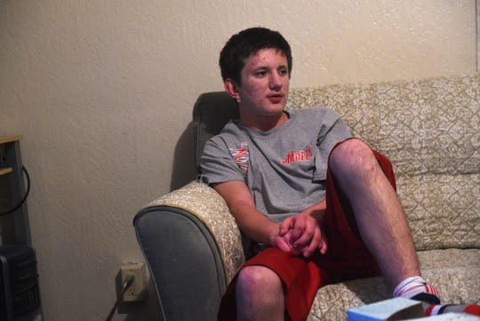 Logan Clark, who was shot at Hug High by a Washoe County School District police officer two years ago,  talks with the RGJ while sitting in his grandmother's home in Reno on Dec. 5, 2018.