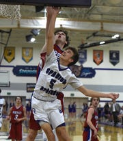 Spanish Springs' Brock O'Connell goes up to shoot with Reno's Tommy Challis coving him during Tuesday's game at Spanish Springs  on Feb. 6, 2018.