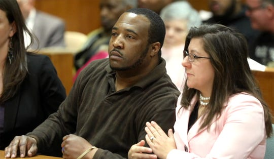Assistant Public Defender Elizabeth Riley pats Silvon Simmons arm after Monroe County Court Judge Christopher Ciaccio announces the reversal of the weapons conviction against Simmons.  Simmons was also found not guilty of attempted murder of a police officer.