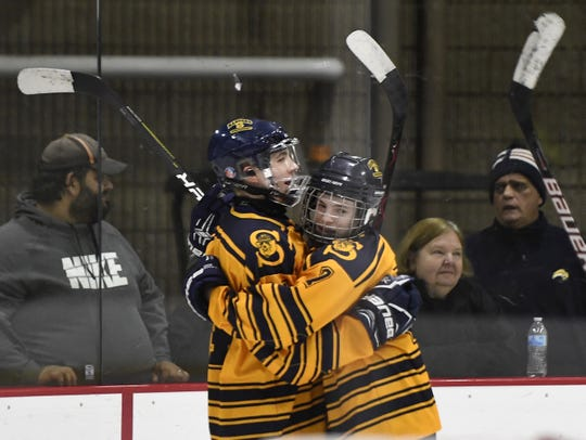 Spencerport's Mark Neu, left, and Jason Uebelacker celebrate the Rangers' fifth goal during a regular season game against Gates Chili played at Genesee Valley Ice Arena, Tuesday, Dec. 11, 2018.