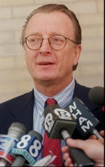 Felix Lapine, defense attorney for Mark Mastin, talks to the media during a recess from a hearing on evidence in the case held Wednesday, June 26, 1996, at the Ontario County Courthouse in Canandaigua. (Staff Photo/Shawn Dowd)