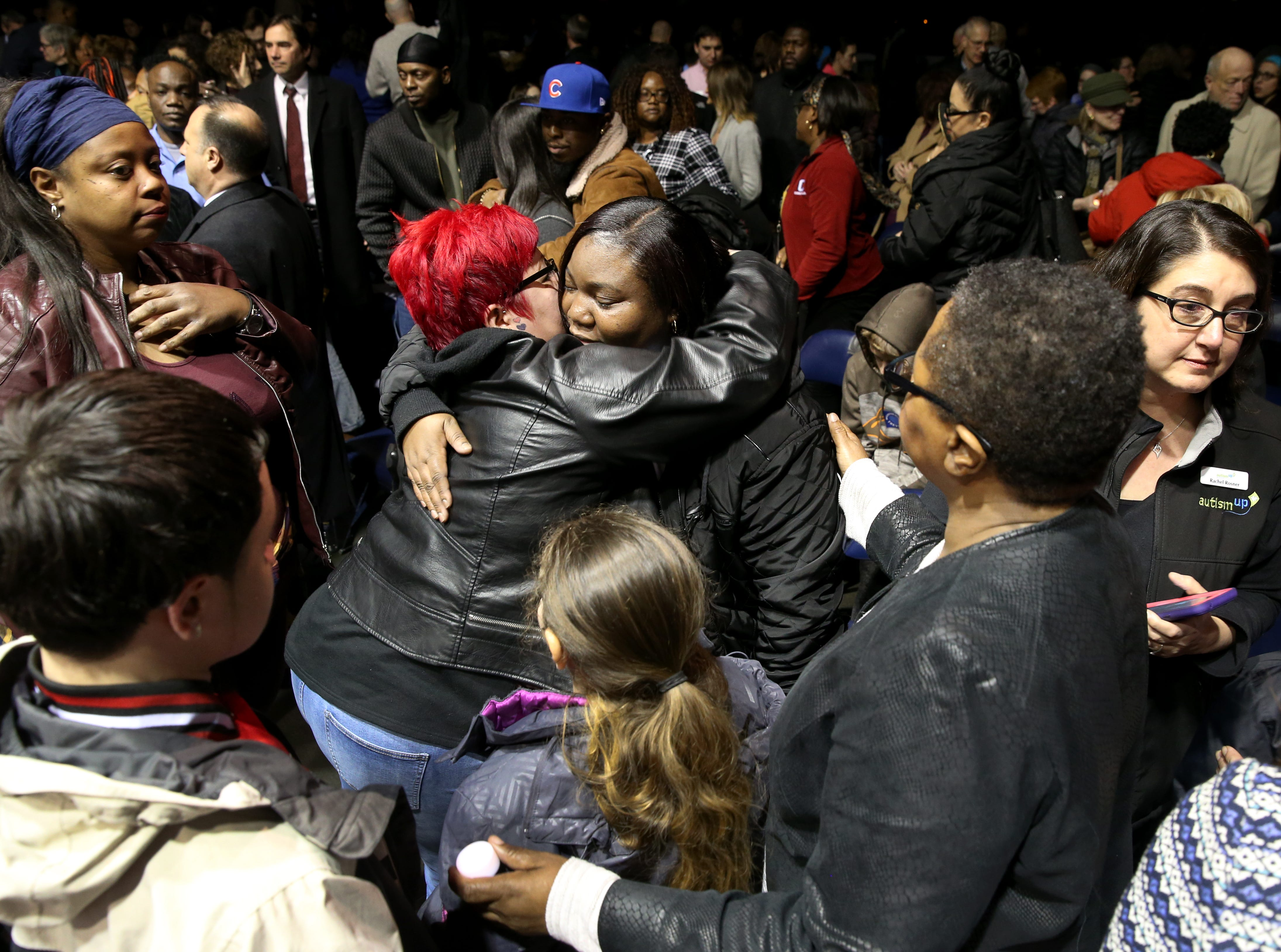 Carrie Houston, mother of Trevyan Rowe, is embraced by many after the vigil for her son whose disappearance brought an outpouring of community support.  I held my camera over my head and wasn't looking thought the view finder when I made this photo. I was surprised to see how well it was composed, with Carrie Houston centered in an embrace and surrounded by a community expressing their condolences for the loss of  Trevyan Rowe.