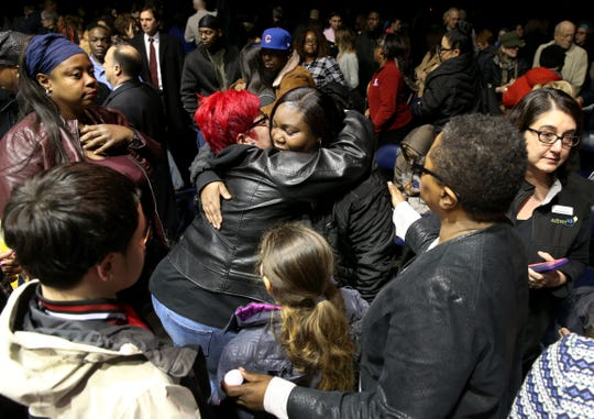 Carrie Houston, mother of Trevyan Rowe, is embraced by many after the vigil for her son, whose disappearance brought an outpouring of community support.