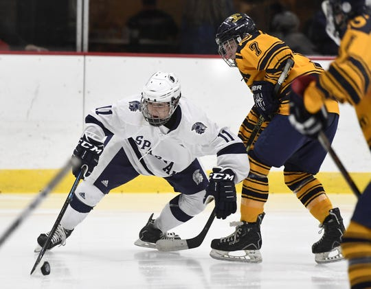 Gates Chili's Ethan Knauf, left, is defended by Spencerport's Jason Uebelacker during a regular season game played at Genesee Valley Ice Arena, Tuesday, Dec. 11, 2018.