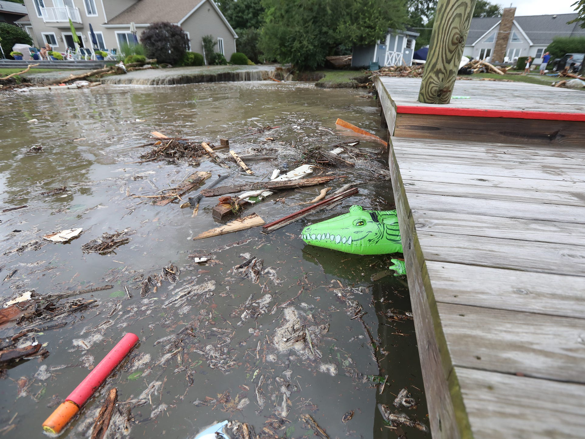 Some possessions and debris were jammed under docks along Seneca Lake after heavy rain caused flooding at Lodi Point, New York on Tuesday, August 14, 2018.