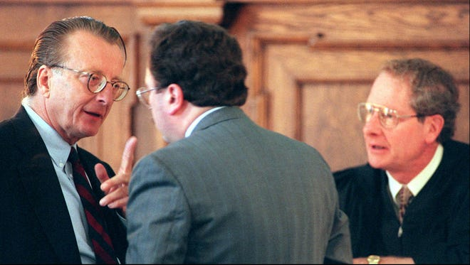 Defense attorney Felix Lapine (L) and Ontario County DA, Michael Tantillo pictured having a heated discussion at the bench before Ontario County Court Judge James Harvey on the first day of the Mark Mastin trial in Canandaigua in 1996. Mastin was charged in an arson fire that claimed the lives of his three children.