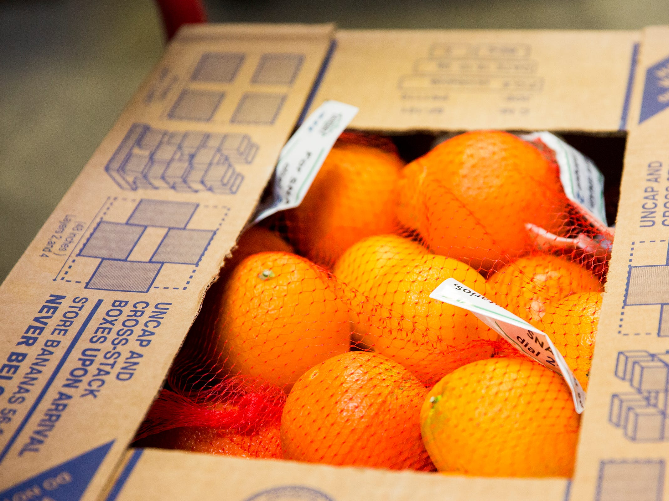 Oranges are collected at the Marion-Polk Food Share on Friday, Dec. 7, 2018. It will be donated to the homeless community living at Wallace Park in Salem.