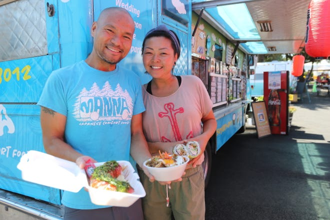 "Francis Ho and Emily Young serve ""good eats from heaven"" at Manna, their Japanese comfort food truck in August 2018."