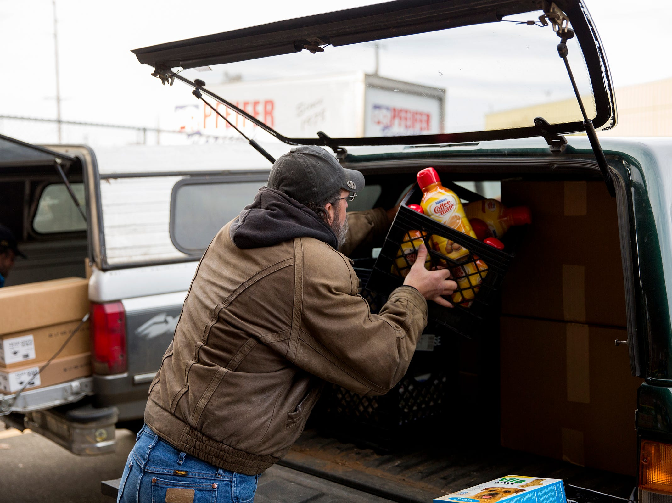 Art Scaglione loads boxes of food into his vehicle at the Marion Polk Food Share on Friday, Dec. 7, 2018. He collects the food for homeless people living in Wallace Marine Park.