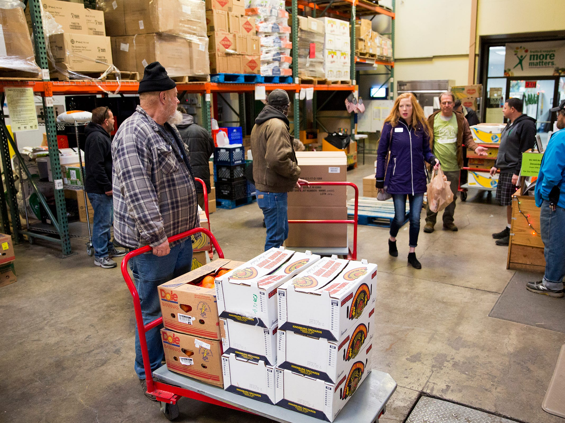 People collect food at Marion-Polk Food Share on Friday, Dec. 7, 2018. The food share has been around since 1987.