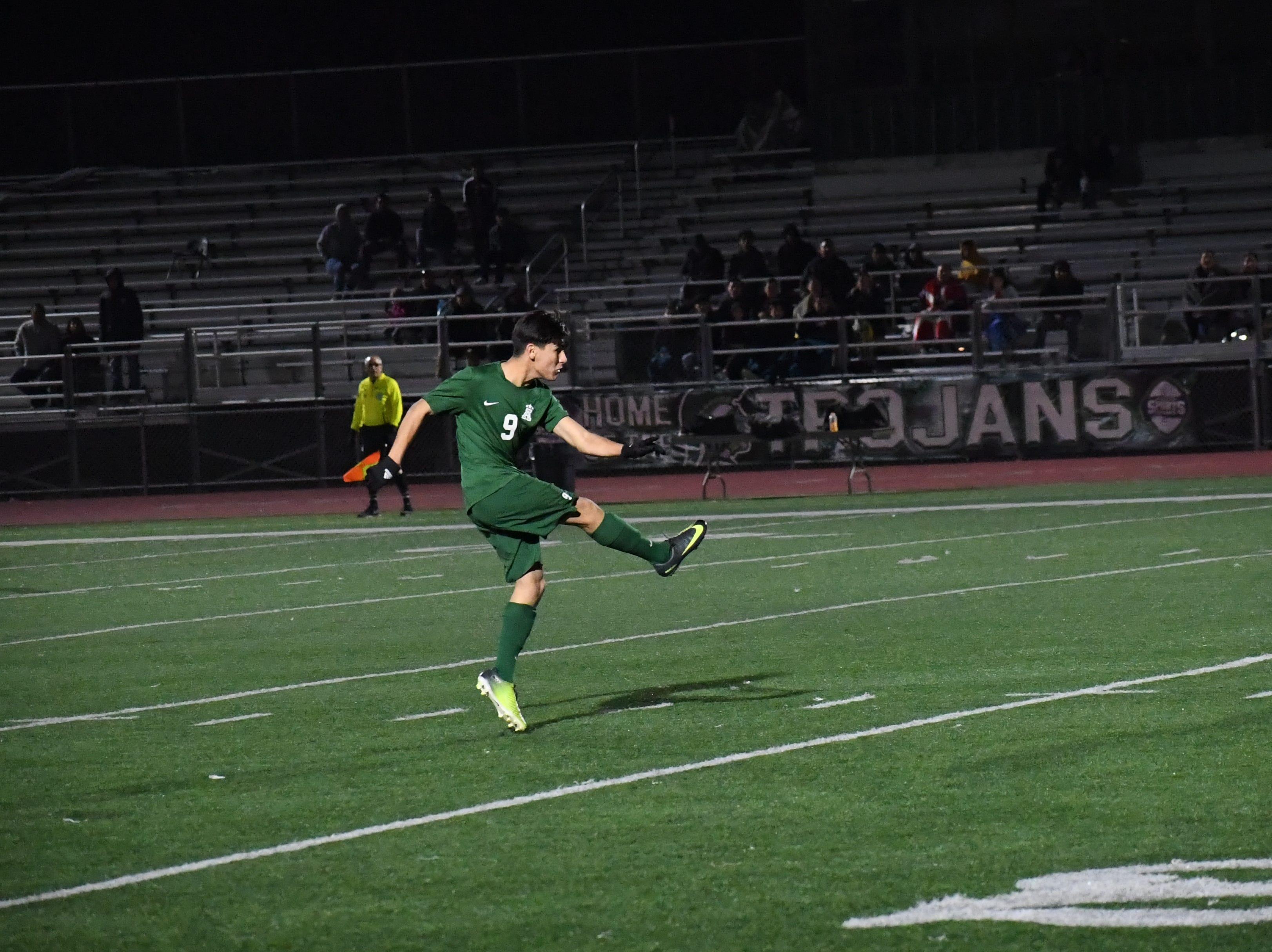 Midfielder Ruben Vasquez (9) launches a free kick towards the Bellarmine goal.
