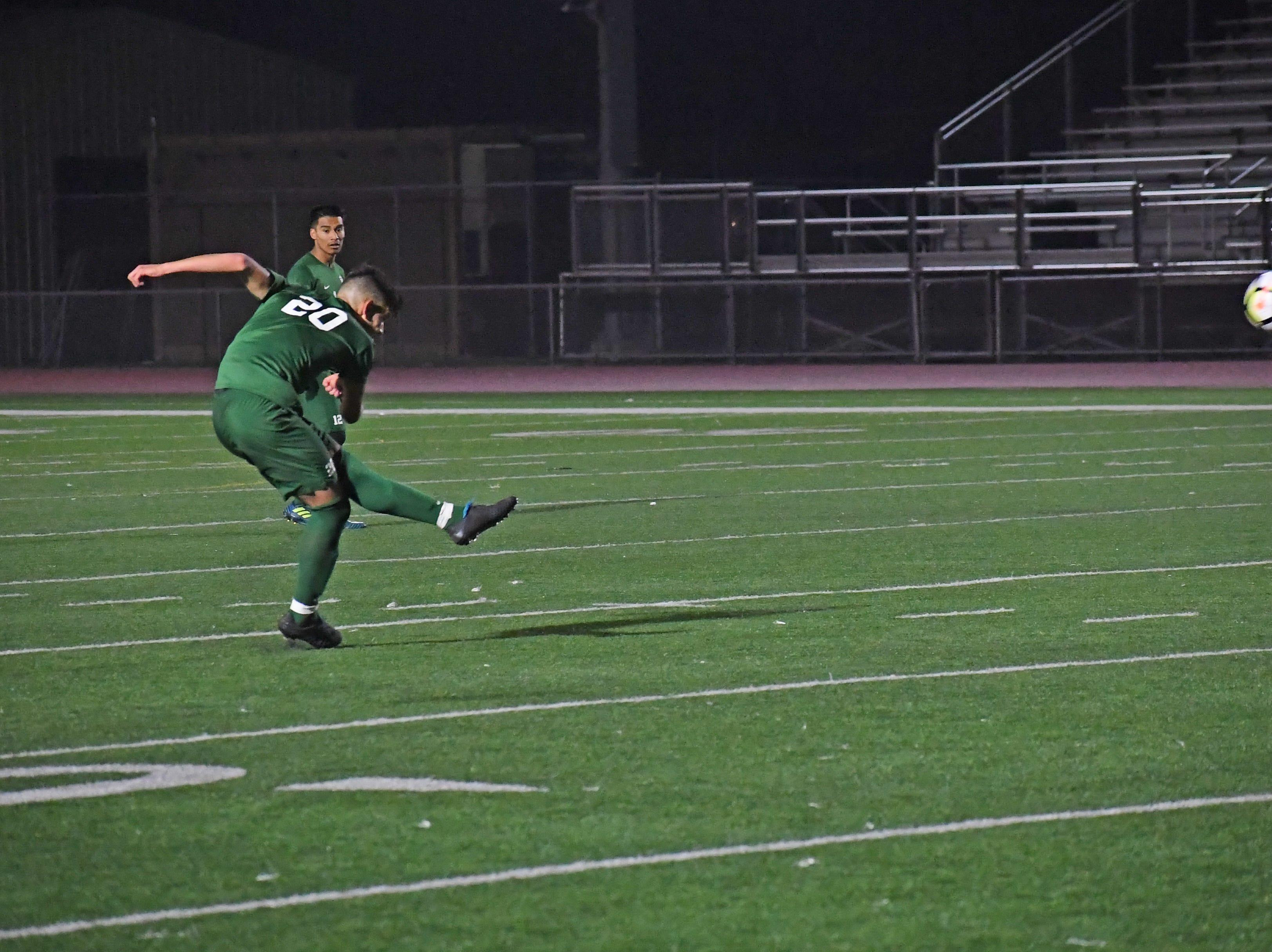 Midfielder Abraham Montaño (20) launches a free kick towards the Bellarmine goal.