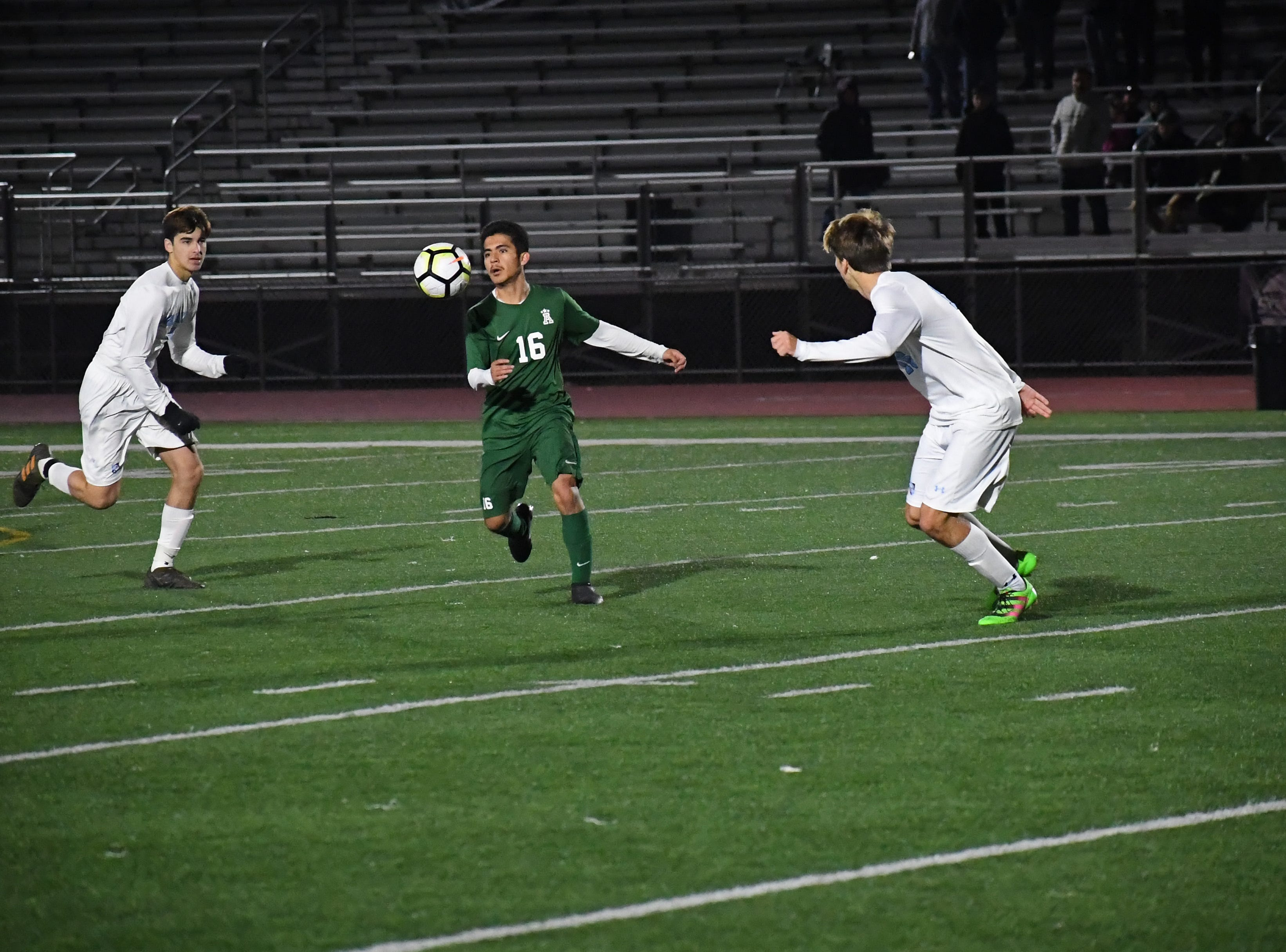 Forward Orlando Juarez-Hernandez (16) looks for a teammate after corralling a header.