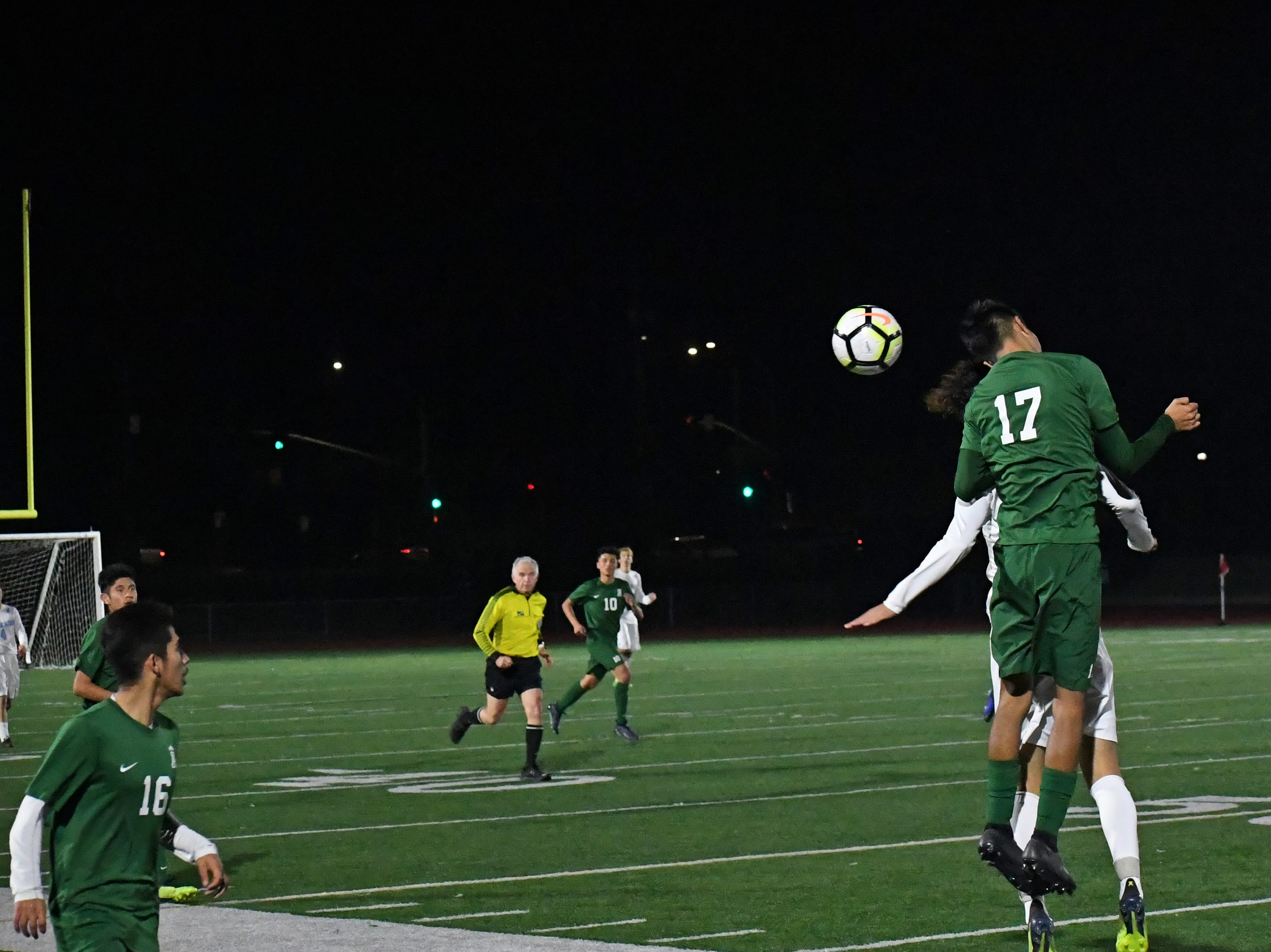 Defender Angel Medrano (17) knocks a header towards the attacking side in the second half.