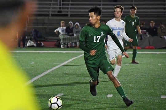 Defender Angel Medrano (17) was an all-league player with the Trojans last season. In January, he'll have a chance to earn a spot overseas with a German club.