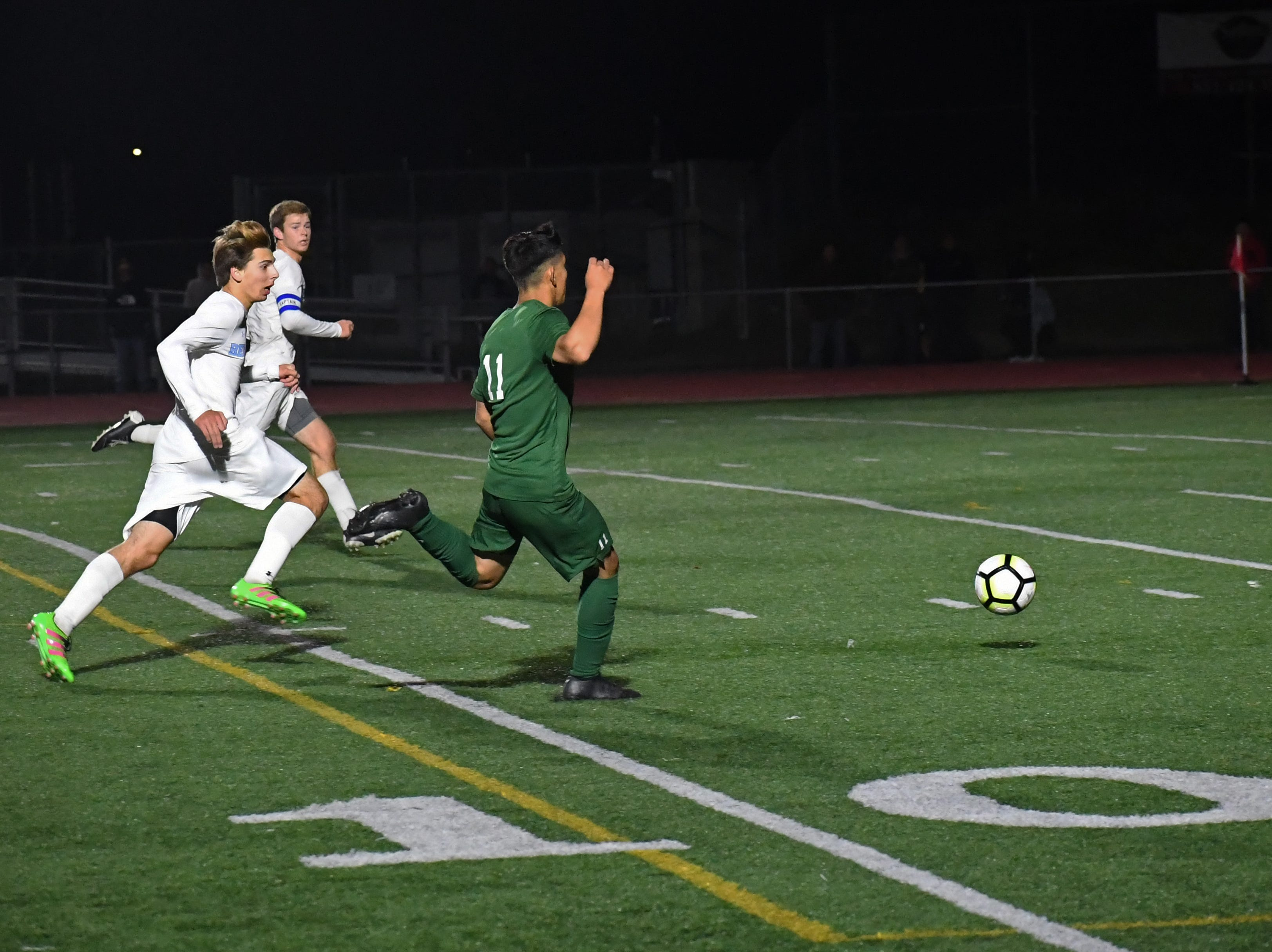 Midfielder Juan Garcia-Duran (11) fires a shot from just outside the box in the second half.
