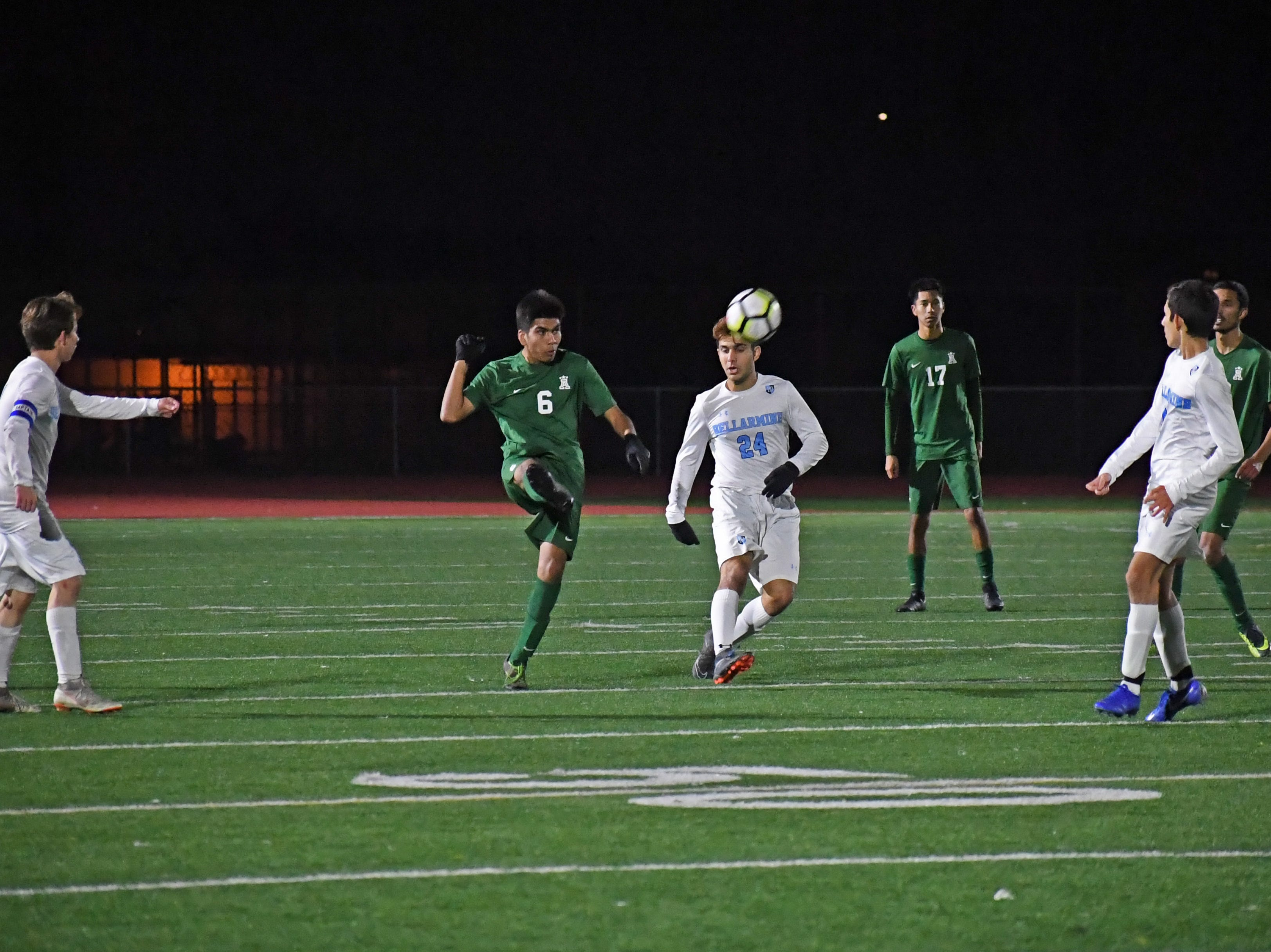 Defender Gabriel San Pablo (6) knocks a ball toward the Bellarmine side of the field after a goalie kick.