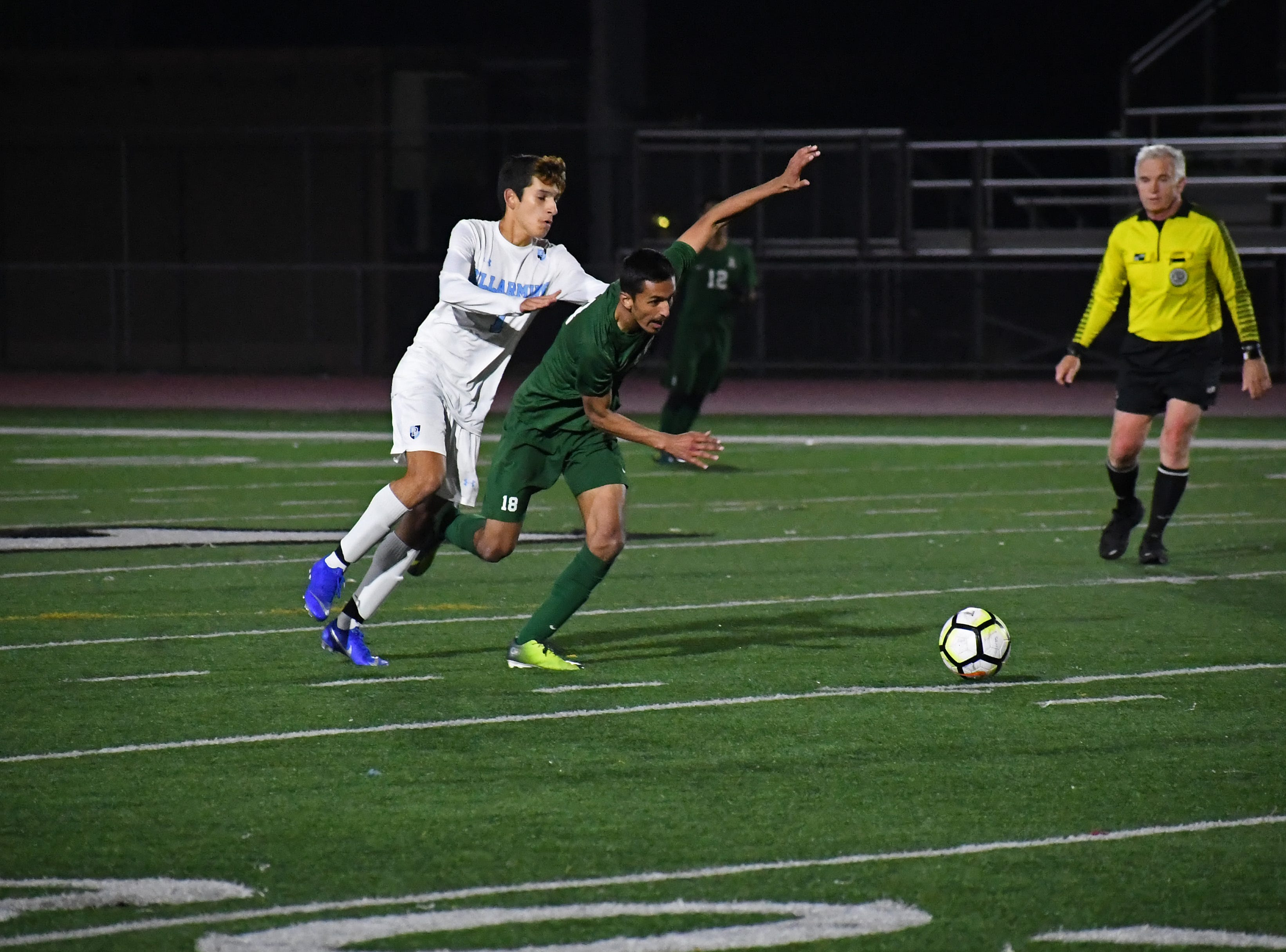 Forward Adiel Kuri-Cubillo (18) attempts to maintain his footing while sprinting towards the Bellarmine goal.
