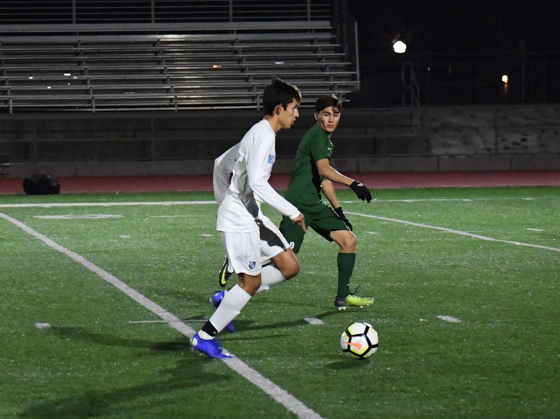 Midfielder Ruben Vasquez (9) sprints up to defend against a Bellarmine forward.
