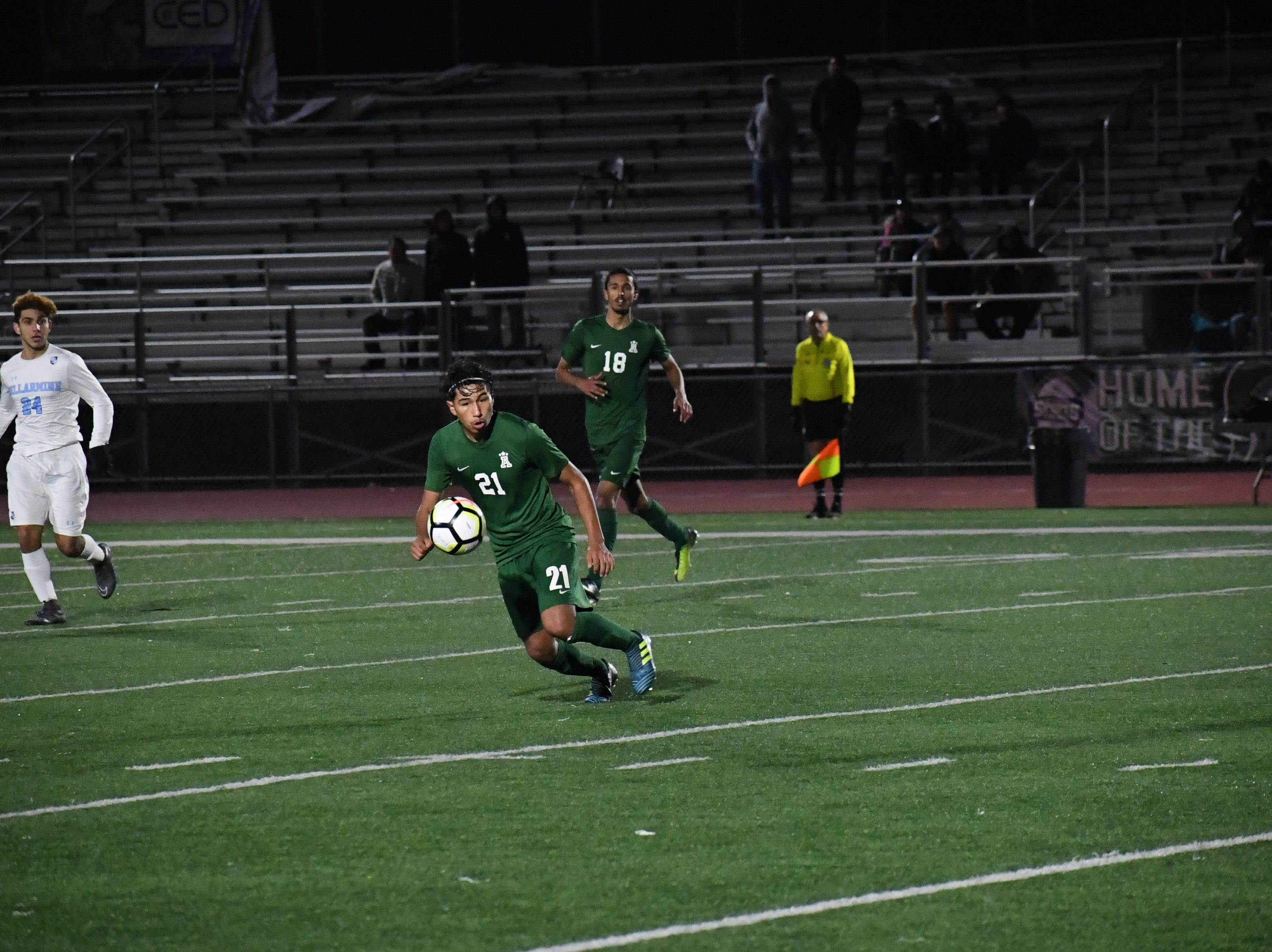 Midfielder Sergio Mejia-Sanchez (21) chases down the ball after a header.