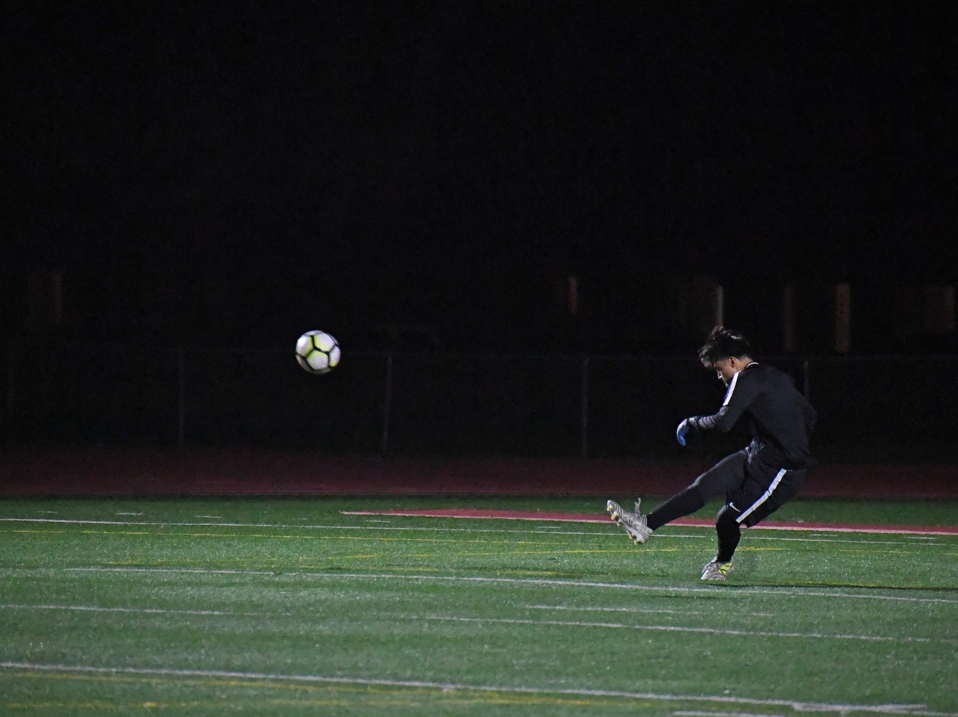 Goalkeeper Luis Canseco launches a kick down the right side after making a save.