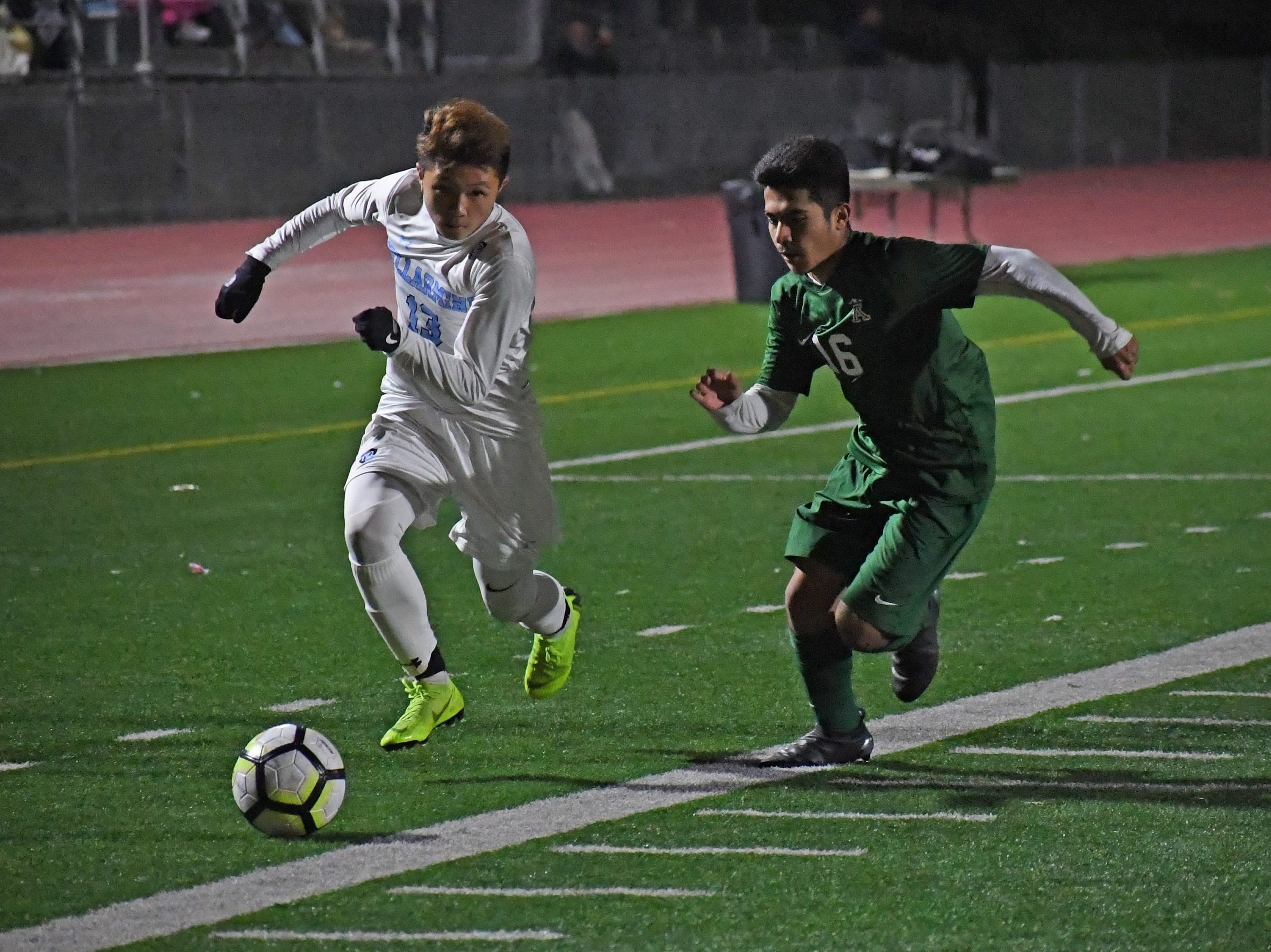 Forward Orlando Juarez-Hernandez (16) shadows a Bellarmine player on the attack.