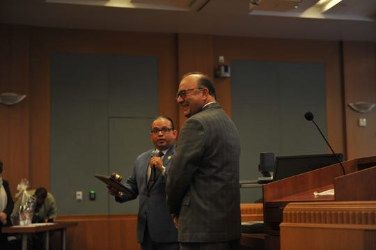 Supervisor Luis Alejo presents Supervisor Simón Salinas an award at Tuesday's board of supervisors session.
