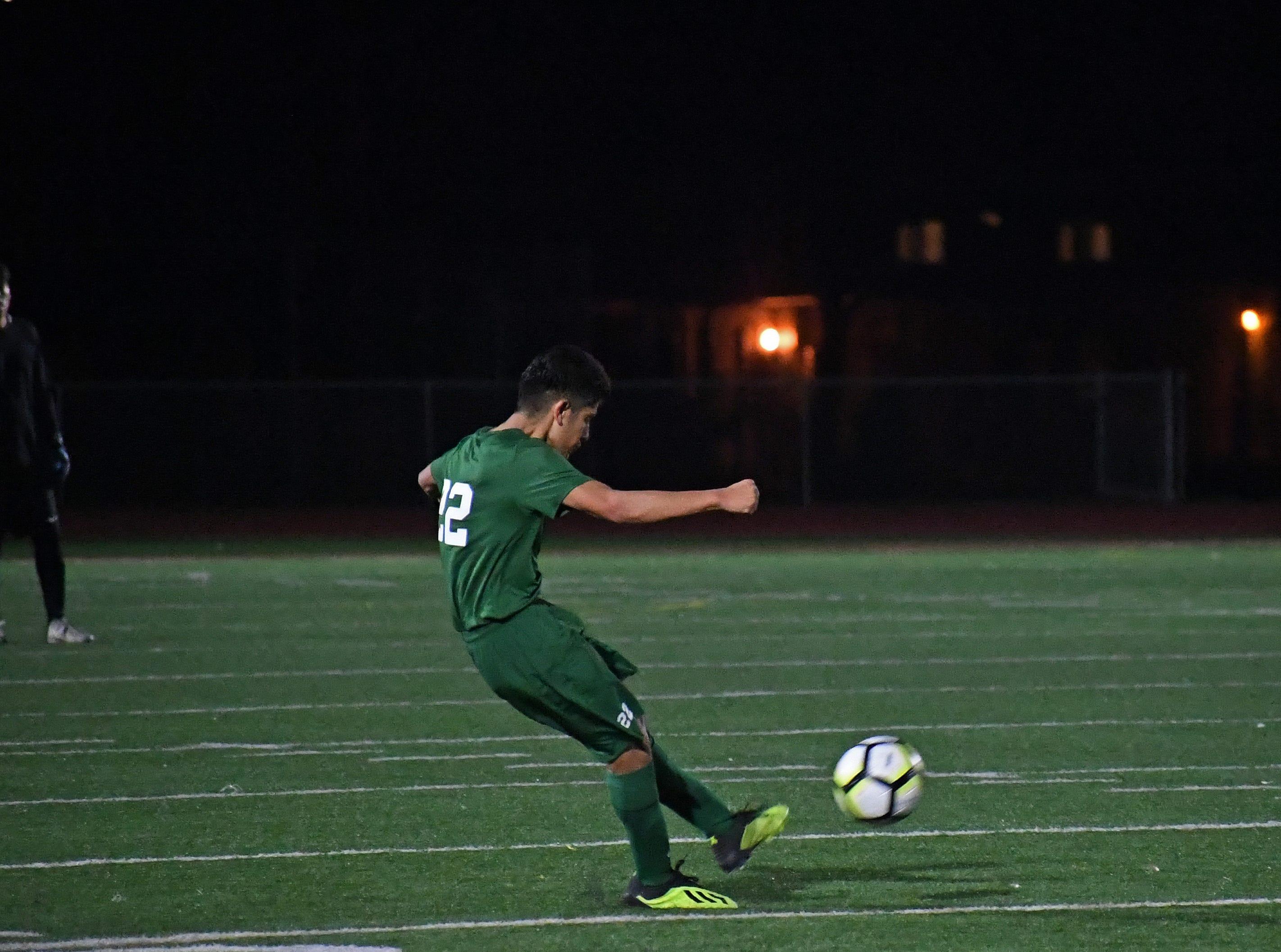 Defender Victor Beltran-Jacobo (22) powers a free kick towards the Bellarmine goal.