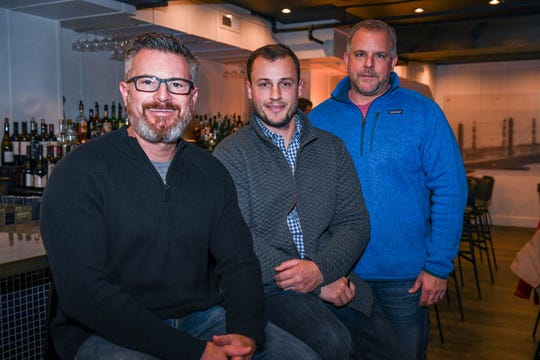 In this file photo, owners Bob Suppies, Tyler Townsend and Dave Gonce (left to right) pose at their new Rehoboth Beach restaurant The Pines on Tuesday, Dec 11, 2018.