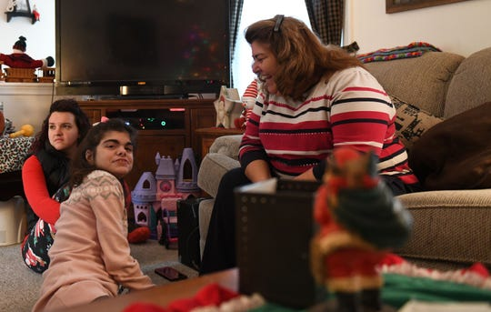 Amanda Ehrisman (Middle) with her mom Cathy (Right) and friend Allison Doria (Left) on Monday, Dec. 10, 2018 at their home in Ocean Pines.