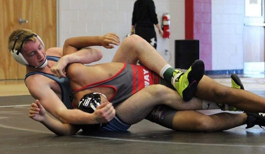 Airline's Tucker Almond wrestles at a recent tournament.