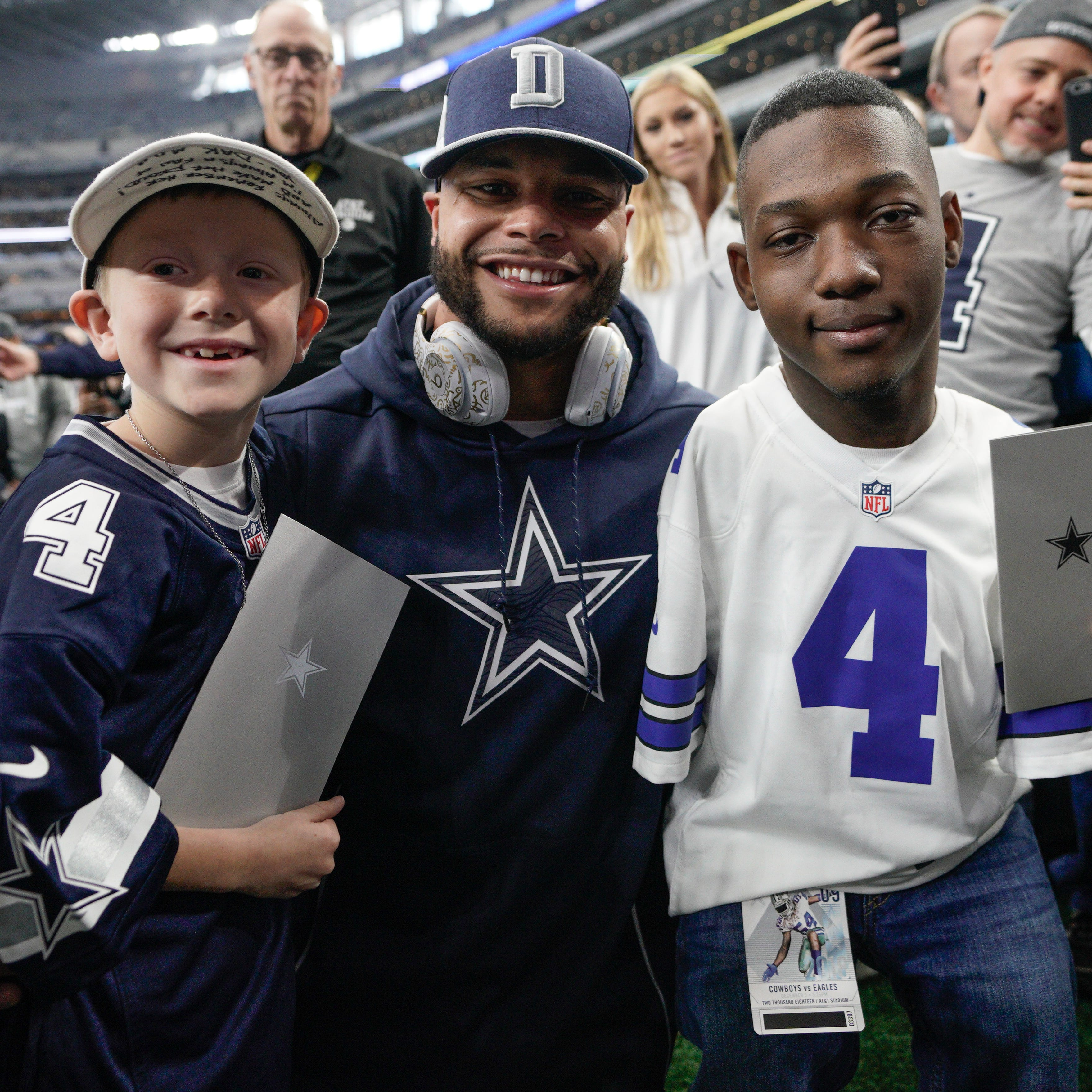 Young boys peel away Dak Prescott's fame, provide inspiration
