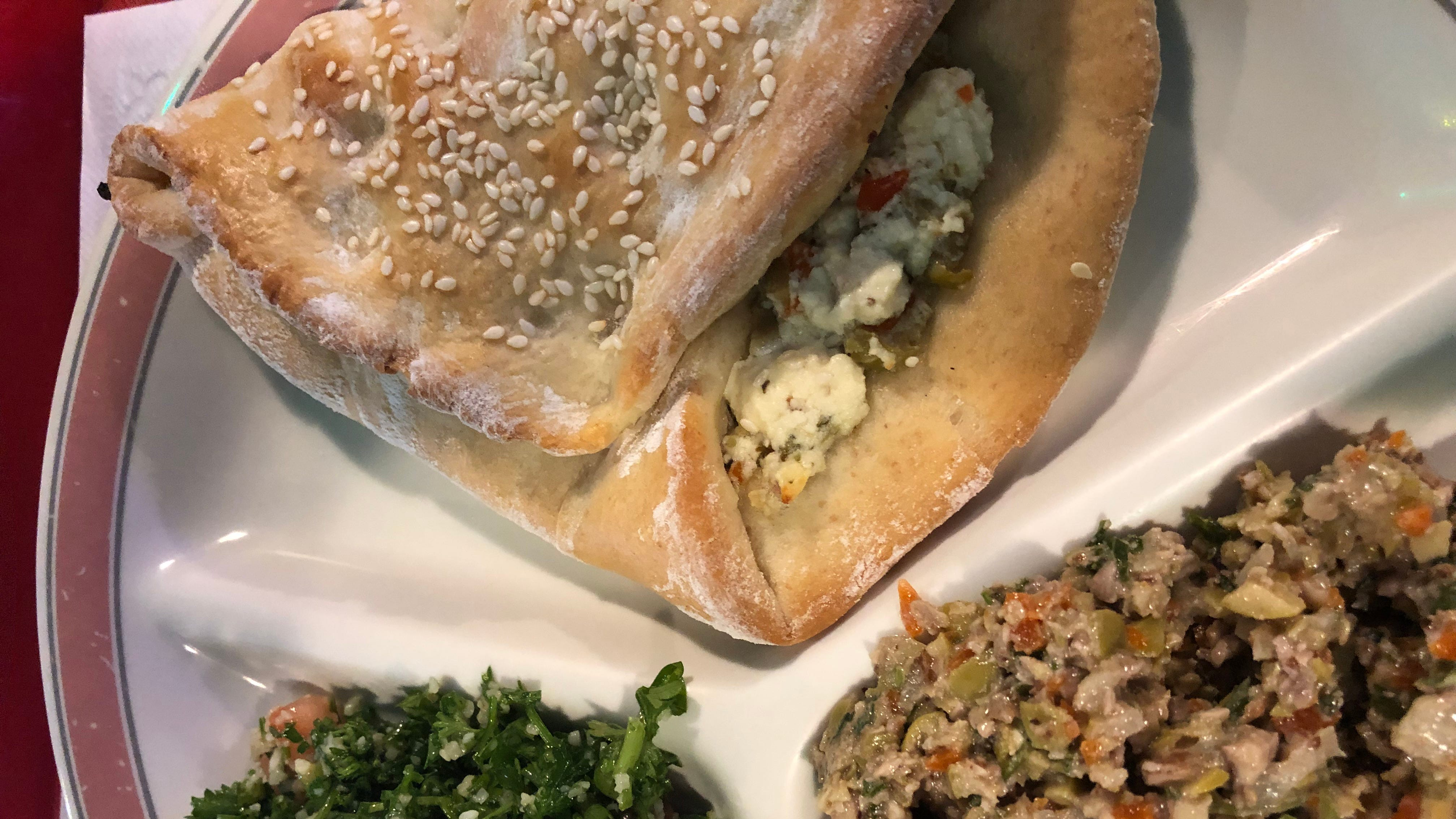 Feta, Olive and Oregano fatayer with tabbouleh and green olive tapenade.