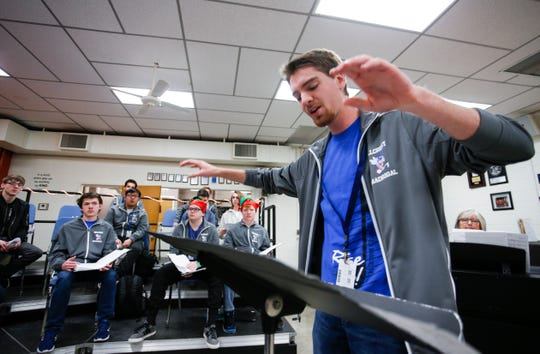Hayden Pyle, a senior at Hillcrest High School, leads a choir class as they sing a musical composition he wrote on Tuesday, Dec. 11, 2018.