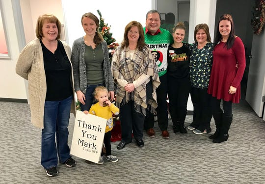 BAYADA employees pause after being given anywhere from $50 to $200 Dec. 11. Pictured: Lisa Cooper, LPN, from left, Charlotte and Amanda Satterfield, RN, Rebecca Kahler, LPN, Aaron Anothayanontha,  RN-Division Director, Kira Palmer, RN- Clinical Manager, Julie Lenz, LPN, and Sarah Cobb, Client Services Manager.
