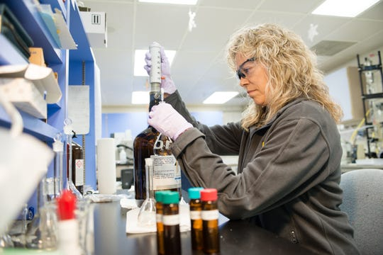 A DNR chemist in Jefferson City tests a water well sample for the presence of TCE, a carcinogenic chemical that's been found in groundwater in northwest Springfield.