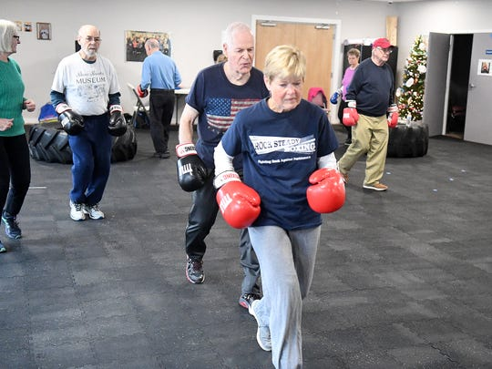 Judy Briggs, who has Parkinson's disease, jogs a lap around the room with the rest of the students during a Rock Steady class at the Staunton-Augusta YMCA on Dec. 5, 2018. Briggs also serves as a coach with the program