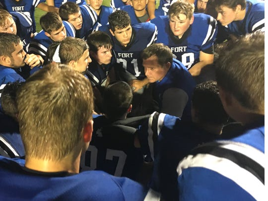 Dan Rolfe talks with his team following a game this season. Rolfe is The News Leader's Coach of the Year.