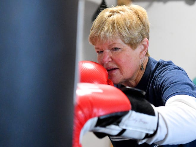 Judy Briggs, who has Parkinson's disease, punches the heavy bag during a Rock Steady class at the Staunton-Augusta YMCA on Dec. 5, 2018. Briggs also serves as a coach with the program