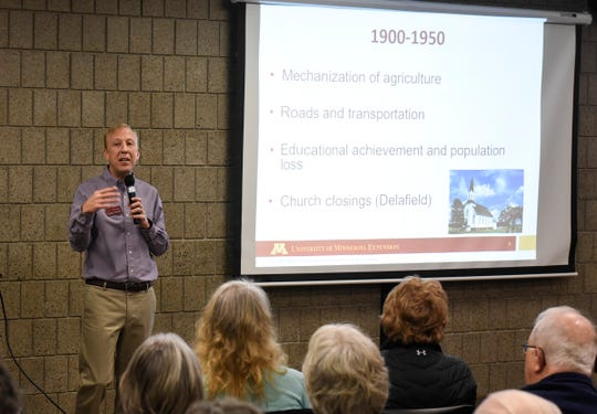 """Researcher Benjamin Winchester talks during his presentation """"Rewriting the Rural Narrative"""" Wednesday, Dec.  12, at the Stearns History Museum in St. Cloud."""