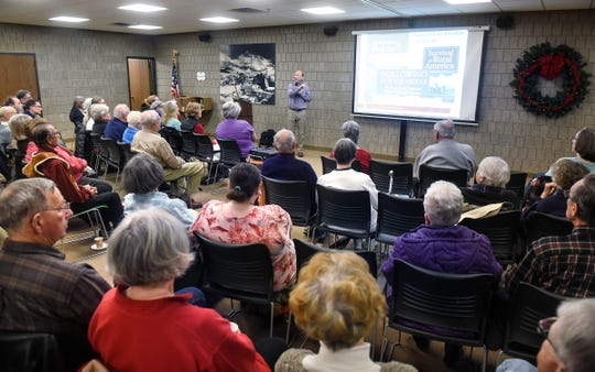 """Researcher Benjamin Winchester speaks during his presentation """"Rewriting the Rural Narrative""""  Wednesday, Dec.  12, at the Stearns History Museum in St. Cloud."""
