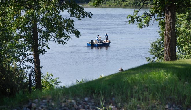 Fishermen try their luck near the shoreline of homes along the Mississippi River in 2018.