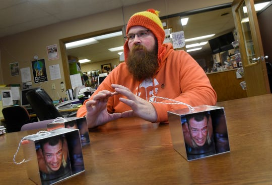"""Adam Lewis talks about his """"Die Hard""""-themed Christmas ornaments during an interview Wednesday, Dec. 12, in St. Cloud."""