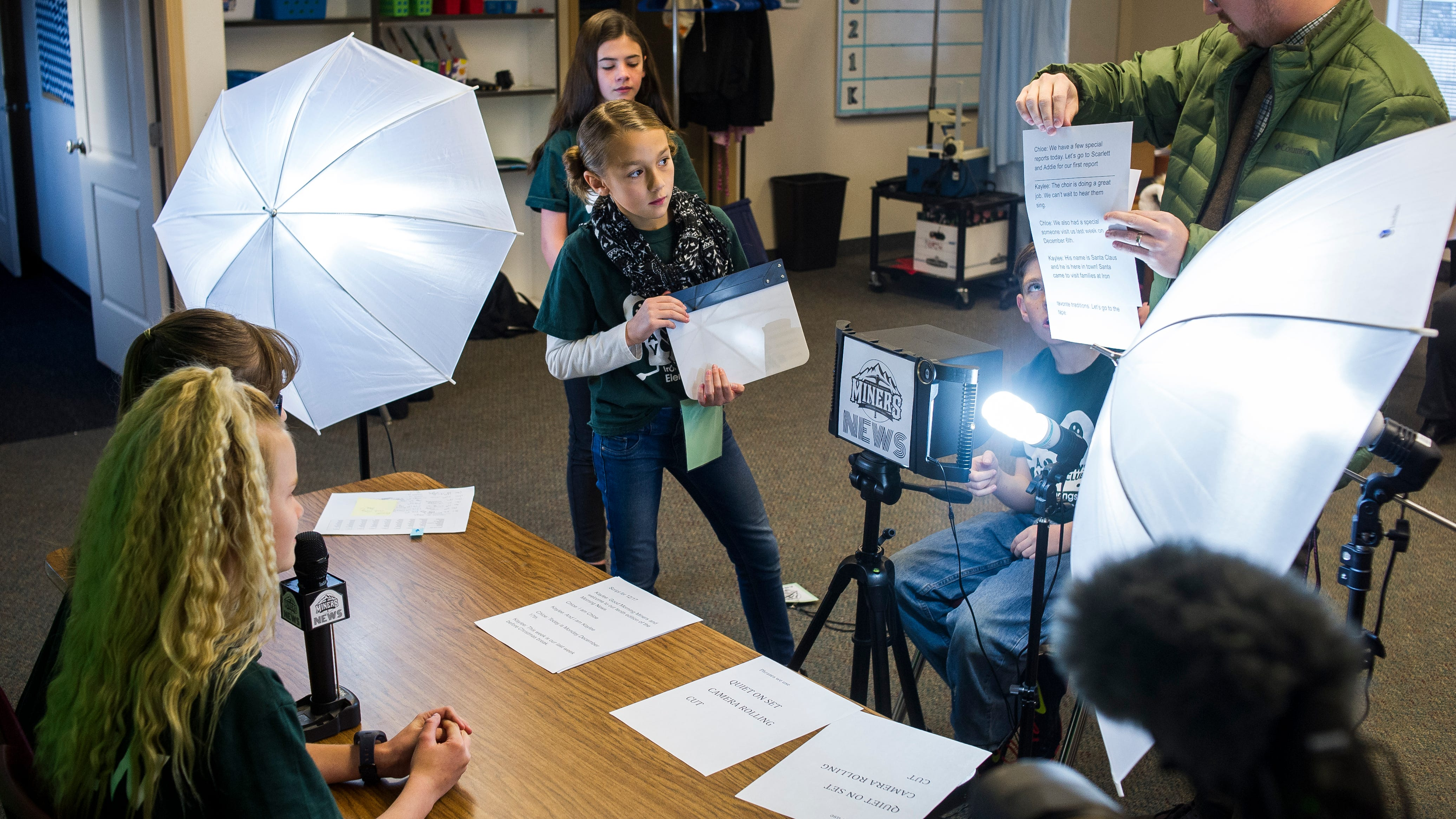 """Iron Springs Elementary School students record """"Miners News,"""" a weekly news show, on Wednesday, Dec. 12, 2018. The Cedar City students reported on school spirit day, teacher interviews, and winter solstice."""