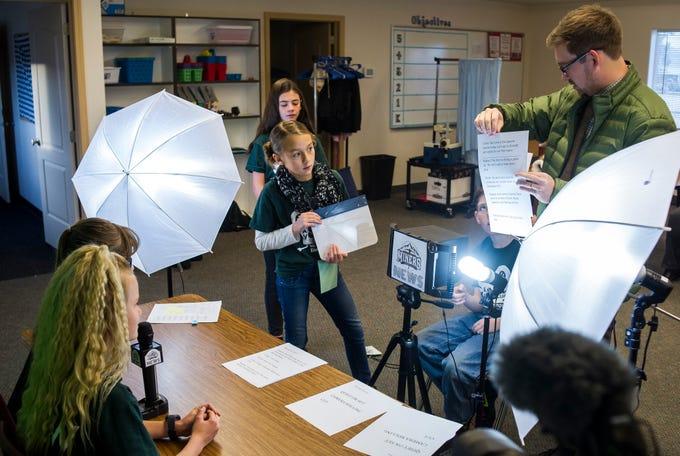 "Iron Springs Elementary School students record ""Miners News,"" a weekly news show, on Wednesday, Dec. 12, 2018. The Cedar City students reported on school spirit day, teacher interviews, and winter solstice."