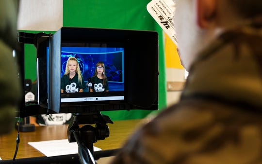 Iron Springs Elementary School anchors read a news broadcast Wednesday, Dec. 12, 2018. The students reported on school spirit day, teacher interviews, and winter solstice. To be part of the program, the children joined a student leadership program and submitted a video audition.