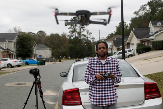 Pablo Correa, 42, flies the drone he uses to make documentary movies at his home Tuesday, Dec. 11, 2018. Correa will graduate with his PhD from Florida State University on Friday, Dec. 14, 2018.