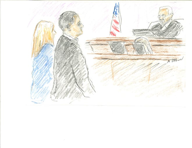 Scott Maddox and Paige Carter-Smith stand before Judge Charles Stampelos in federal court on Wednesday, December 12, 2018.