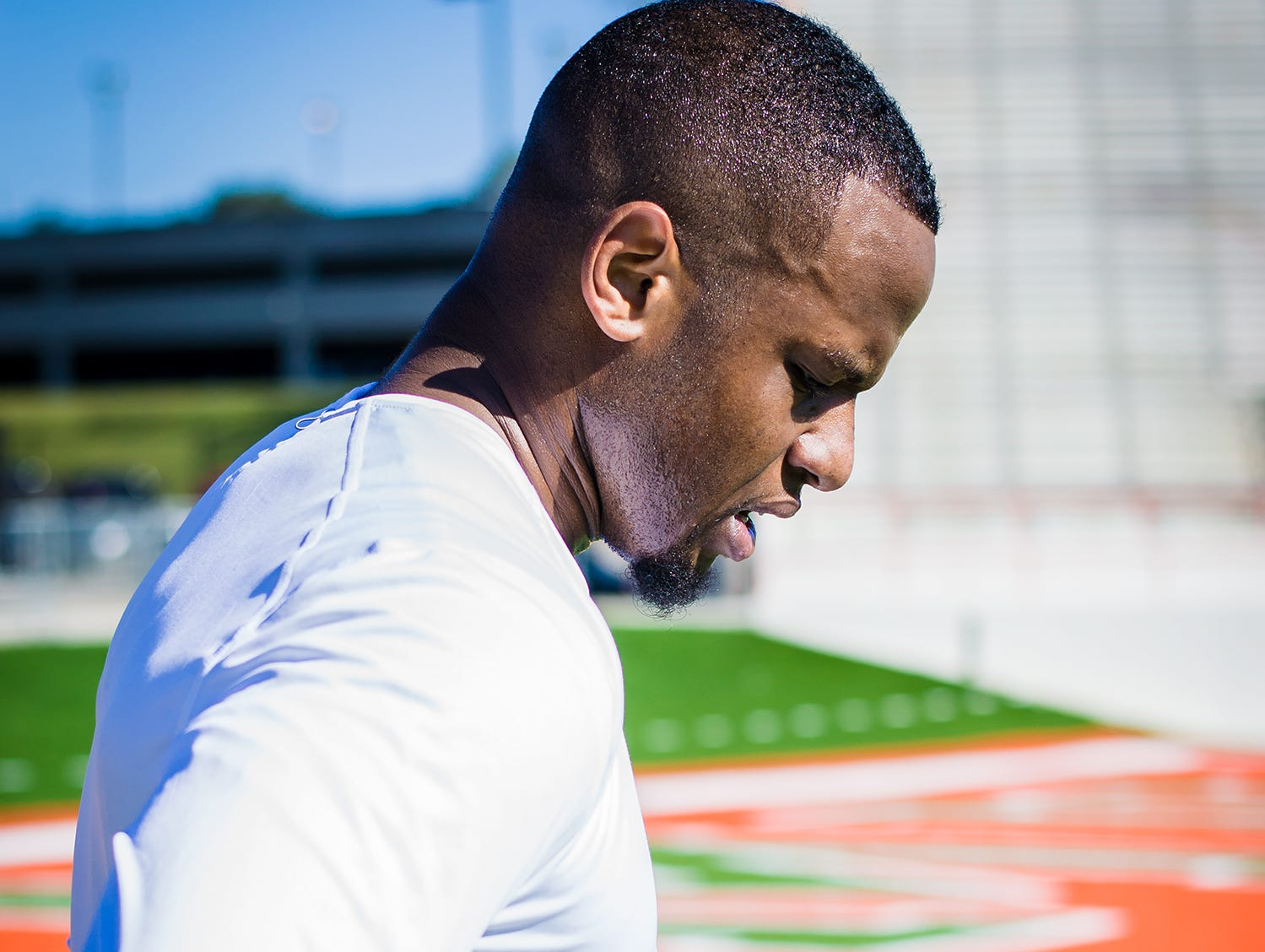 Akil Blount pauses for a breather between workouts at Bragg Memorial Stadium.