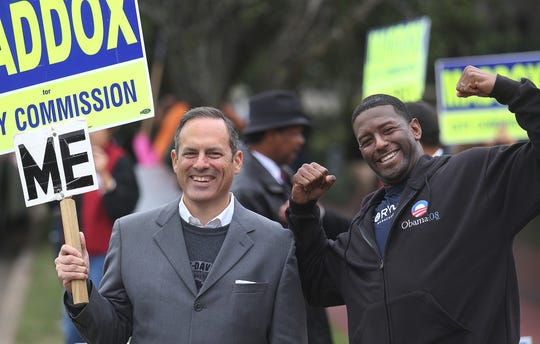 In this Oct. 28, 2012 file photo, Scott Maddox (left) and then-City Commissioner Andrew Gillum pose for the cameras during early voting outside the County Courthouse.